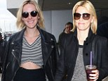 The Hunger Games - Catching Flight: Jena Malone and Elizabeth Banks on top of the world at airport as film set to top box office