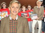'I'm trying to get world peace!' Ellen DeGeneres jokes about role as 2014 Oscar host as she attends children's charity event