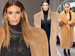 Un-bare-ably cold! Kim Kardashian dons the same furry brown coat twice in one week but continues to expose her cleavage as she braves East Coast winter