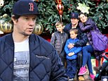 Spreading the holiday cheer! Mark Wahlberg, his wife Rhea Durham, and their sons Michael, left, and Brendan, right, took a family photo at Main Street's Christmas tree at California's Disneyland on Saturday