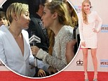 Miley Cyrus's big sister, Brandi, steals the show at the American Music Awards by stunning the crowd in a gorgeous white beaded dress