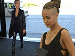 Are you seeing this, Will? Jada Pinkett Smith is a leather-clad knockout as she flashes her bra in in thigh-high chained boots