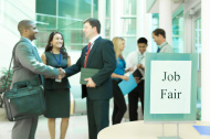 Business: Unemployed professionals attend a job fair.