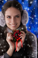 Winter Girl Holding a Christmas Decoration