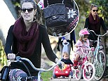 That's so L.A.! Alessandra Ambrosio wears a $4,000 Chanel purse during a neighborhood bicycle ride as her two tots trail behind
