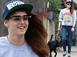 A reason to smile! Kristen Stewart carries on her grunge style in flip up shades and sweat shirt to walk her dog