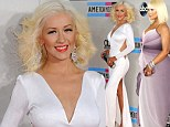 What a difference a year makes! Christina Aguilera is a shadow of her former self as she poses in a revealing white gown at the 2013 AMA awards