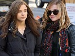 Brunette to blonde: Chloe Moretz takes her wig off to enjoy a Christmas Fair with her family during a break from filming new movie