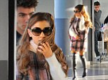 All time HIGH! Ariana Grande looks glam in pink tartan cape and racy leather boots as she arrives in New York with boyfriend Nathan Sykes