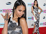 You've got to hand it to her! Stunning Zoe Saldana shows off dazzling ring-to-wrist bracelet as she presents at AMA's