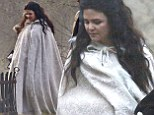 That's one way to hide a baby bump! Pregnant Ginnifer Goodwin is dressed in a billowing cape as she shoots Once Upon A Time alongside fiancé Josh Dallas