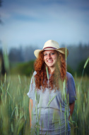 Country girl in a green field