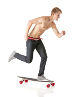 Young male riding on skateboard