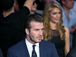 David Beckham enjoys boxing match while Paris Hilton appears to hover in the background