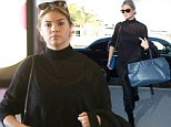 Look, I can do demure too! Kate Upton is dressed head-to-toe in black as she struts through airport