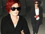 Sharon Osbourne makes her way across Los Angeles International Airport on Monday