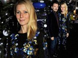 She's the bauble of the ball:Gwyneth Paltrow blends in with Christmas tree decorations in patterned dress at children's charity dinner