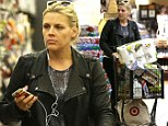 Rocker mom, not a soccer mom! Busy Philipps wears a leather motorcycle jacket and iPod while she grocery shops for Thanksgiving in Los Feliz