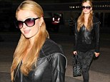 'I never made a dollar': Paris Hilton answers questions about the sex tape scandal as she greets fans at LAX