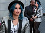 Demi Lovato embraces edgy look in glittery jacket, leather trousers and black hat over her bright blue hair