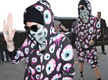 Can you not SEE this is a bad outfit! Kesha's bizarre eyeball print ensemble, complete with mask