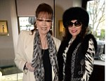 Animal antics: Both sisters stepped out in animal print, with Joan favouring a zebra print dress and Jackie a leopard print scarf