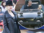 Gwen Stefani displays her blossoming baby bump as she and Gavin Rossdale treat their sons to a Disneyland trip