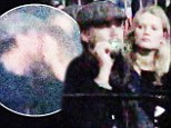 What split? Leonardo DiCaprio kisses and cuddles his model girlfriend at a Kanye West concert, amid break-up rumours