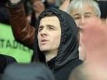Away fan: QPR midfielder Joey Barton cheers on Marseille in their Champions League clash at Emirates Stadium