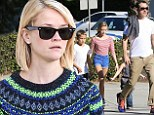 Reese Witherspoon gets in the festive spirit with a decidedly Christmassy sweater as she stocks up on Thanksgiving supplies with her family