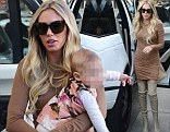Doting mother: Petra Ecclestone wore an eye-catching outfit on Tuesday as she held her baby daughter Lavinia during a shopping trip in Beverly Hills, California