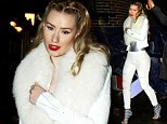 Caught in the rain! Iggy Azalea tries to keep her whites dry as she makes her way to the Late Show with David Letterman