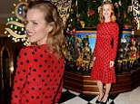 Hello baubles! Supermodel Eva Herzigova goes dotty for Claridge's Christmas tree in festive red spotty dress