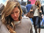 She's just getting warmed up! Make-up free Gisele Bundchen flicks her hair as she struts into photo shoot wearing skinny jeans and leather knee-high boots