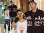 Ashton Kutcher wraps his arm around Mila Kunis after cosy dinner together