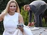 Mr Mom! Dax Shepard stays home to set up holiday decorations as Kristen Bell heads out for glamorous night at AMAs