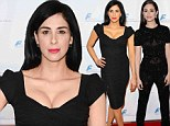 Black magic! Sarah Silverman and Emmy Rossum showcase their stunning figures in the most bewitching hue at gala event