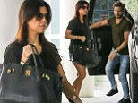 Kourtney Kardashian flashes pins in ripped denim shorts as she runs errands with Scott Disick
