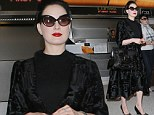 Now that's how to make an entrance! Dita Von Teese oozes glamour in crushed velvet coat and cat's eye sunglasses as she jets out of LAX
