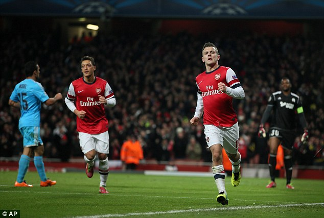 At the double: Jack Wilshere (second from right) celebrates after converting Ozil's pass for his second goal against Marseille