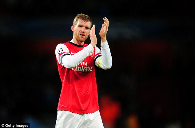Confident: Per Mertesacker believes his German international team-mate Ozil will improve as the season goes on
