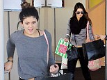 Shop 'til you drop: Kendall and Kylie Jenner coordinate in grey as they enjoy mall spree ahead of family Thanksgiving celebration