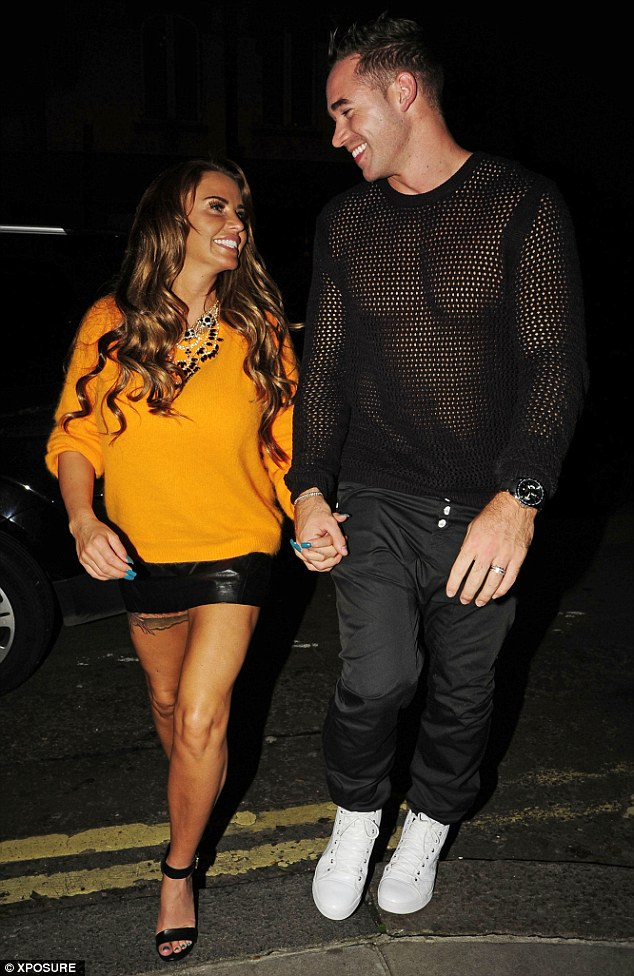 The look of love: Katie Price and husband Kieran Hayler are in a cheerful mood outside Novikov in London on Thursday evening