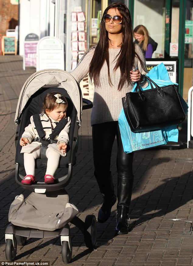 Stroll in the sun: Chantelle wore some oversized sunglasses to complete her outfit