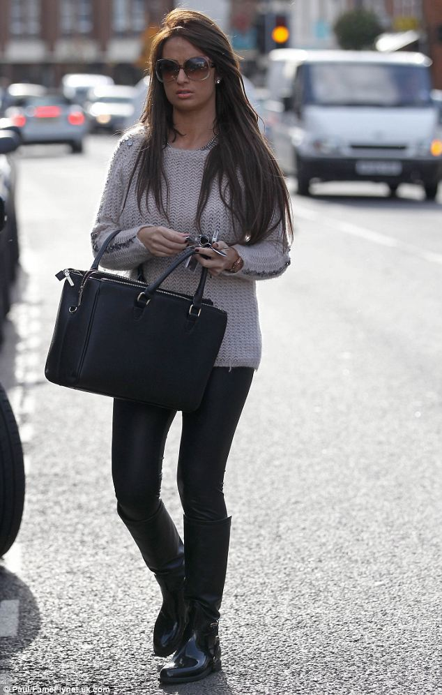 Home time: Chantelle looked tired but content as she got into her car at the end of the day