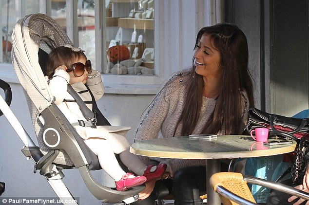 Dress-up: Chantelle gazes at her daughter as she tries on mummy's sunglasses