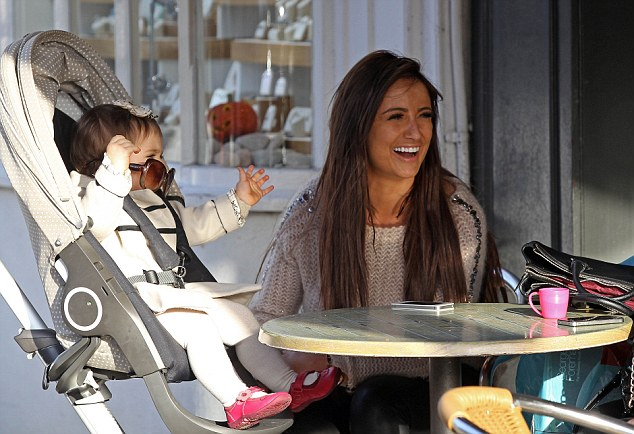 Girly day out: Chantelle is amused by the antics of her daughter, who tries on her sunglasses