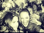 Posing: Selena Gomez posts a picture of herself posing with fans in Illinois, Chicago