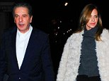 Close: Charles Saatchi with his dinner date Trinny Woodall on Monday, who today wrote that cocaine and alcohol turned her into a 'fake, lying, thieving, cheating person'