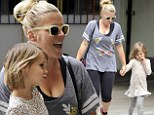 Bonding with her cub! Make-up free Busy Philipps runs errands with her leopard print-clad daughter Birdie